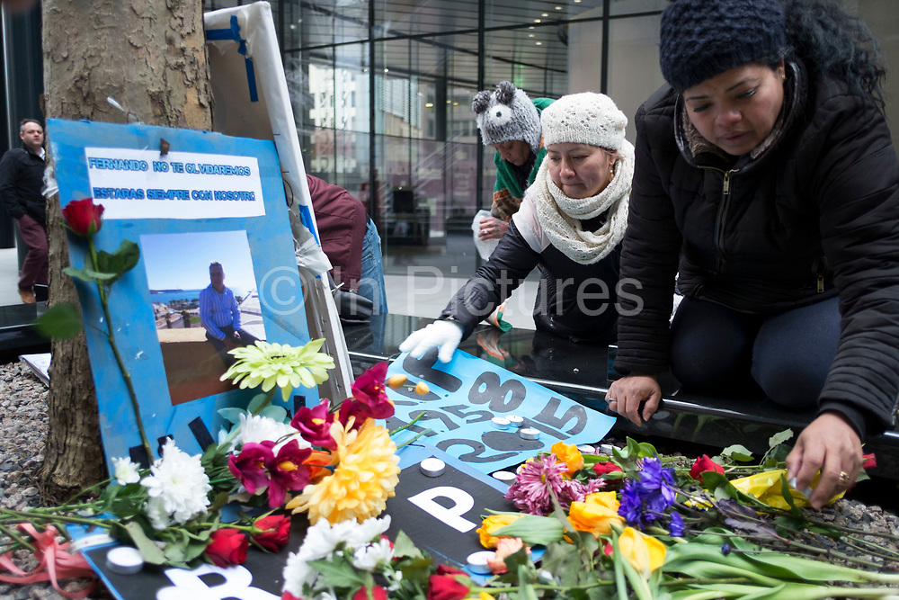 """Protest for Fernando Montero outside his old workplace. London, UK. On 17th December 2015, Fernando Montero died following a heart attack. For the last 5 years he was employed as a cleaner by outsourcing giant Servest at the Willis Building, in the City. During this time, he was victim of a destructive workplace culture. His supervisors repeatedly shouted at him in public, refused him the right to use the toilet outside of break time, and failed to grant him annual leave. On the day of his death, Fernando called a friend in a state of distress. Too anxious to return to work, due to the treatment of himself and fellow workers. A few hours later, he was dead. For his wife Francia (pictured), the link between workplace stress and his death is straightforward: """"He passed away of a heart attack because of the stress brought about by the abuse and bullying of his bosses."""""""
