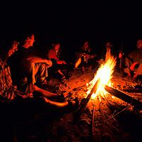 Tourists sit around a campfire, Ban Pak Ou, Luang Phrabang, Laos