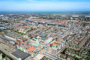 Nederland, Noord-Holland, Zaandam, 20-04-2015; Overzicht Zaandam met Inverdan, nieuwe stadscentrum Zaandam, masterplan Sjoerd Soeters. Met Station, Stadhuis en het Zaanse huisjeshotel - Inntel Hotel - een ontwerp Wilfried van Winden.<br /> New center of the city of Zaandam, developed according to the master plan by architect Sjoerd Soeters. Train station and city hall. The hotel built in a postmodern version of the style of the historic houses of Zaandam - Inntel Hotel - was designed by Wilfried van Winden.<br /> luchtfoto (toeslag op standard tarieven);<br /> aerial photo (additional fee required);<br /> copyright foto/photo Siebe Swart