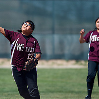 050213       Cable Hoover<br /> <br /> Tohatchi Cougar Garolynn Wood (13) throws to first to stop a Zuni Thunderbird runner Thursday at Tochatchi High School.