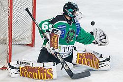 Goalie Matija Pintaric (HDD Tilia Olimpija, #69) catches the puck during ice-hockey match between HDD Tilia Olimpija and EV Vienna Capitals in 36rd Round of EBEL league, on Januar 7, 2011 at Hala Tivoli, Ljubljana, Slovenia. (Photo By Matic Klansek Velej / Sportida.com)