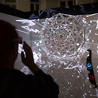 Viewer watches an artistic 3D light installation during the Zsolnay Light Festival held in central Pecs, Hungary on June 30, 2018. ATTILA VOLGYI