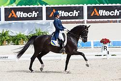 Inna Logutenkova, (UKR), Don Gregorius - Grand Prix Team Competition Dressage - Alltech FEI World Equestrian Games™ 2014 - Normandy, France.<br /> © Hippo Foto Team - Leanjo de Koster<br /> 25/06/14
