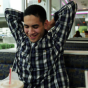 11/15/02<br />While waiting for his connecting bus in Houston, Angel relaxes in a nearby McDonalds.