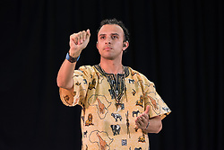 "10 March 2018, Arusha, Tanzania: Fabian Gutiérrez, a deaf participant at the CWME, introduces plenary session on Mission from the Margins. From 8-13 March 2018, the World Council of Churches organizes the Conference on World Mission and Evangelism in Arusha, Tanzania. The conference is themed ""Moving in the Spirit: Called to Transforming Discipleship"", and is part of a long tradition of similar conferences, organized every decade."