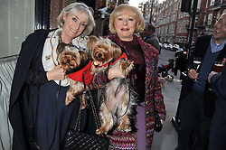 Left to right, AMANDA ELLIOT and the COUNTESS OF DARTMOUTH with dogs Pom Pom & Pixie at the 10th anniversary of George in association with The Dog's Trust held at George, 87-88 Mount Street, Mayfair, London on 13th September 2011.