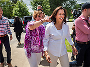 03 JULY 2019 - WEST DES MOINES, IOWA: Iowa State Senator CLAIRE CELSI (left) walks US Senator KAMALA HARRIS (D-CA) into the West Des Moines Democrats' annual 4th of July Picnic. Senator Harris attended the picnic to support her bid to be the Democratic nominee for the US presidency in 2020. Iowa hosts the first presidential selection event of the 2020 election cycle. The Iowa Caucuses are scheduled for Feb. 3, 2020.        PHOTO BY JACK KURTZ