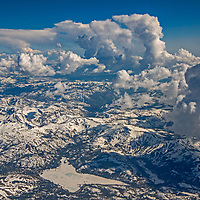 Aerial view south over California's Sierra Nevada, with Caples Lake and Kirkwood Ski Area in foreground.