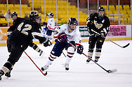 October 13, 2007 - Anchorage, Alaska: Scott Kobialko (28) of the Robert Morris Colonials pushes the puck into the Warrior zone as Ryan Adams (42) of the Wayne State Warriors tries to stop him in the Colonials 4-1 victory over the Wayne State Warriors at the Nye Frontier Classic at the Sullivan Arena.