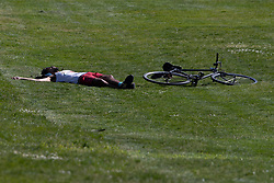 © Licensed to London News Pictures. 22/04/2020. London, UK. A member of the public sunbathes in Greenwich Park. Temperatures are set to rise throughout the rest of the week. Photo credit: George Cracknell Wright/LNP