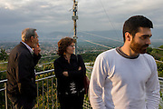 Italian relatives on a rooftop of their home in the village of Somma Vesuviana, in the Red (evacuation) Zone on the western slope of Vesvius, Somma, Italy.