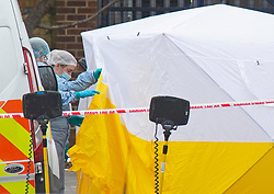 © Licensed to London News Pictures 31/03/2021. Croydon, UK. Forensics officers on scene. One man is dead and two injured after a triple stabbing in Croydon, South East London last night. Police are on scene with a large cordon in place. Photo credit:Grant Falvey/LNP