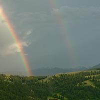 A rainbow arcs over the Story Hills near Bozeman, Montana.