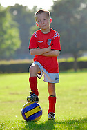Young Boy Standing with Football - Model Released