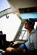 Oil industry Saudi Arabia, helicopter Bell 206 JetRanger 1979 pilot in cockpit