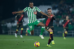 December 9, 2018 - Seville, Andalucía, Spain - Sidnei, Real Betis, and Álvaro Garcia, Rayo, fight for the ball during the LaLiga match between Real Betis and Rayo in Benito Villamarín Stadium  (Credit Image: © Javier MontañO/Pacific Press via ZUMA Wire)