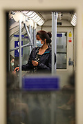 People wearing face protective masks are seen commuting on a Victoria line train in London on Sunday, Sept 13, 2020. The Government enforced a law this year, which makes it mandatory to wear protective face masks on all public transport to help curb the spread of the pandemic outbreak. The British government's scientific advisory board announced on Friday that the reproduction number of coronavirus transmission across the UK was now over 1.0. The Science and the Scientific Advisory Group for Emergencies (SAGE) said the R-value was now between 1.0 and 1.2. (VXP Photo/ Vudi Xhymshiti)