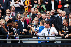England Manger Roy Hodgson presents the trophy to Captain Mark McChrystal after Bristol Rovers win the match on penalties  to secure promotion to the Football League 2 - Photo mandatory by-line: Rogan Thomson/JMP - 07966 386802 - 17/05/2015 - SPORT - FOOTBALL - London, England - Wembley Stadium - Bristol Rovers v Frimsby Town - Vanarama Conference Premier Play-off Final.