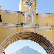 The Volcan de Agua can be seen under the arch at the Santa Catalina in Antigua, Guatemala.
