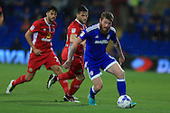 Aron Gunnarsson of Cardiff city ® holds off Craig Conway of Blackburn Rovers (c). EFL Skybet championship match, Cardiff city v Blackburn Rovers at the Cardiff city stadium in Cardiff, South Wales on Wednesday 17th August 2016.<br /> pic by Andrew Orchard, Andrew Orchard sports photography.