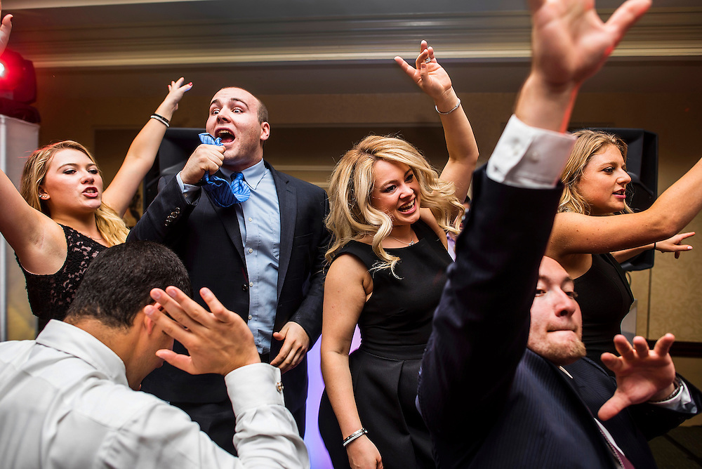 Guests dance during a weddings reception held at Brooklake Country Club in Florham Park, New Jersey. A wedding at Brooklake Country Club in Florham Park, New Jersey.