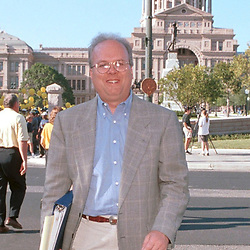 """(AUS01)   Austin, Texas  18AUG99:  Main advisor to Texas Governor George W. Bush in his presidential campaign is Karl Rove, political strategist, who is the 'brains behind the campaign"""". He's shown crossing 11th Street at the State Capitol  AUG10th.  © Bob Daemmrich  <br /> This image will reproduce best up to 3""""x 4"""", 300dpi."""