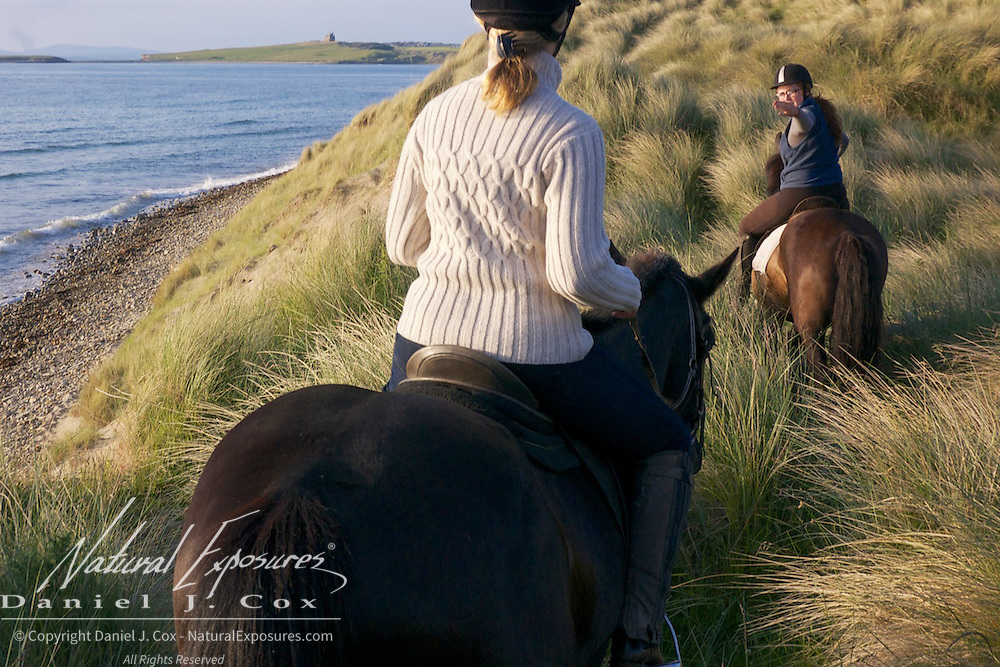Tanya takes a leisurely ride along the coast with Island View Riding Stables, Ireland.
