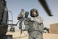 1-244 Air Helicopter Battalion ( part of the 34th Air Brigade) is made up of companies from the Louisiana and Florida National guards. They conduct air assault and air movement operation including acting as a taxi service around  Baghdad flying a ring around the bases before returning to their hub in Balad.  It cost $6000 an hour to operate a blackhawk, so it isn't the most cost effective way to get around but it is the safest. ///SGT Woods, from Florida is a gunner who rides blackhawk helicopters based in Balad Iraq