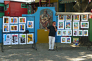 An artist sells his paintings in the La Boca neighborhood on December 29, 2010 in Buenos Aires, Argentina.