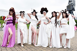 © Licensed to London News Pictures. 25/05/2018. LONDON, UK.  Cosplayers as Hercules'muses and Meg attend MCM Comic Con at Excel in East London.   Thousands of fans of video games, comic books and other popular character take the opportunity to dress up as their favourite characters.  Photo credit: Stephen Chung/LNP