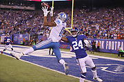 Detroit Lions wide receiver Marvin Jones Jr. (11) leaps and catches a 27 yard touchdown pass good for a 7-0 first quarter Lions lead while covered by New York Giants cornerback Eli Apple (24) during the 2017 NFL week 2 regular season football game against the against the New York Giants, Monday, Sept. 18, 2017 in East Rutherford, N.J. The Lions won the game 24-10. (©Paul Anthony Spinelli)