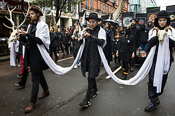 London, UK. 12 October, 2019.  Thousands of climate activists from Extinction Rebellion, many carrying skeletons and bones, take part in the XR funeral march from Marble Arch to Russell Square on the sixth day of International Rebellion protests to demand a government declaration of a climate and ecological emergency, a commitment to halting biodiversity loss and net zero carbon emissions by 2025 and for the government to create and be led by the decisions of a Citizens' Assembly on climate and ecological justice. Credit: Mark Kerrison/Alamy Live News