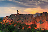 Pitigliano is a medieval town in the Maremma area of Tuscany. The town stands on an abrupt tuff butte high above the Olpeta, the Fiora and the Lente rivers. Taken a few minutes after sunset on an evening at the end of April, this is stitched from five vertical frames