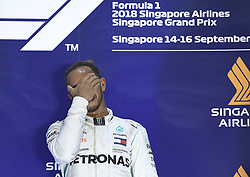 2018?9?16? .??????——F1??????????????..9?16?????????????????????????????2018????F1????????????????????????????????????????????????????????????????? .??????????..Mercedes driver Lewis Hamilton of Britain reacts at the trophy ceremony after winning in the the Formula One Singapore Grand Prix Night Race held at the Marina Bay Street Circuit on Sep 16, 2018. Today, Mercedes driver Lewis Hamilton wins the Formula One Singapore Grand Prix Night Race, followed in second place by Red Bull driver Max Verstappen and in third place by Ferrari driver Sebastian Vettel..By Xinhua, Then Chih Wey..????????????2018?9?16? (Credit Image: © Then Chih Wey/Xinhua via ZUMA Wire)