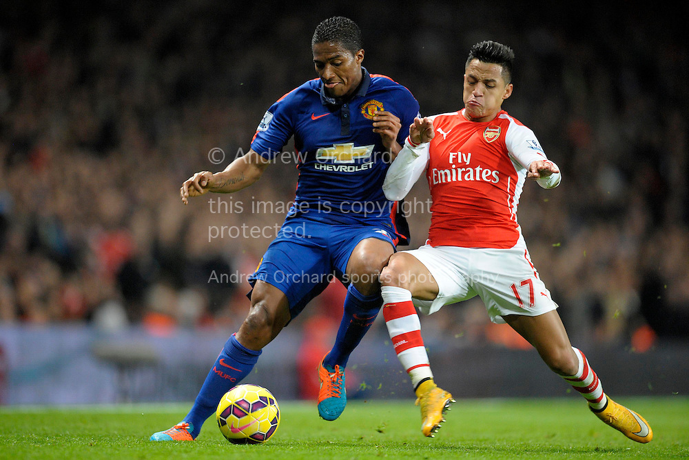 Luis Antonio Valencia of Manchester United and Alexis Sanchez of Arsenal compete for the ball. Barclays Premier league match, Arsenal v Manchester Utd at the Emirates Stadium in London on Saturday 22nd November 2014.<br /> pic by John Patrick Fletcher, Andrew Orchard sports photography.