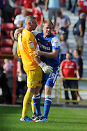 Leyton Orient's Nathan Clarke (r) celebrates his sides win with keeper Ryan Allsop at the end of the match. NPower league one, Swindon Town v Leyton Orient at the County Ground in Swindon on Saturday 8th Sept 2012.  pic by  Andrew Orchard, Andrew Orchard sports photography,