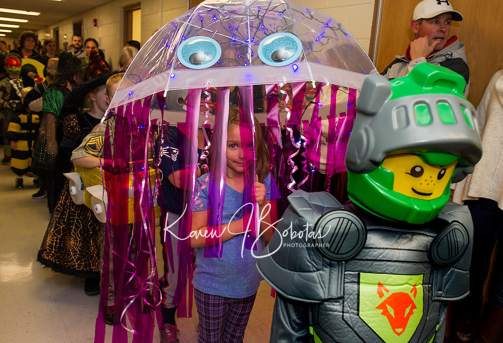"""As a """"Jellyfish"""" Isabella Peavey marches along with her 2nd grade class during the Halloween Parade at Pleasant Street School on Friday afternoon.  (Karen Bobotas/for the Laconia Daily Sun)"""