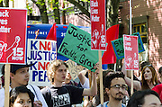 Demonstrators in the Don't Shoot rally march through downtown Portland, Oregon as part of May Day 2015