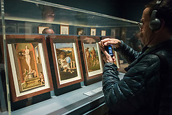 """© Licensed to London News Pictures. 28/02/2019. LONDON, UK. A visitor views works, c1500, by Giovanni Bellini. Preview of """"The Renaissance Nude"""", an exhibition at the Royal Academy of Arts in Piccadilly of 90 works examining the emergence of the nude in European art.  Works by artists including Leonardo da Vinci to Michelangelo are on display in the Sackler Galleries 3 March to 2 June 2019.  Photo credit: Stephen Chung/LNP"""