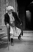 Old man hobbling out of mosque, Yarkand, edge of Taklamakan desert, far western China, Central Asia