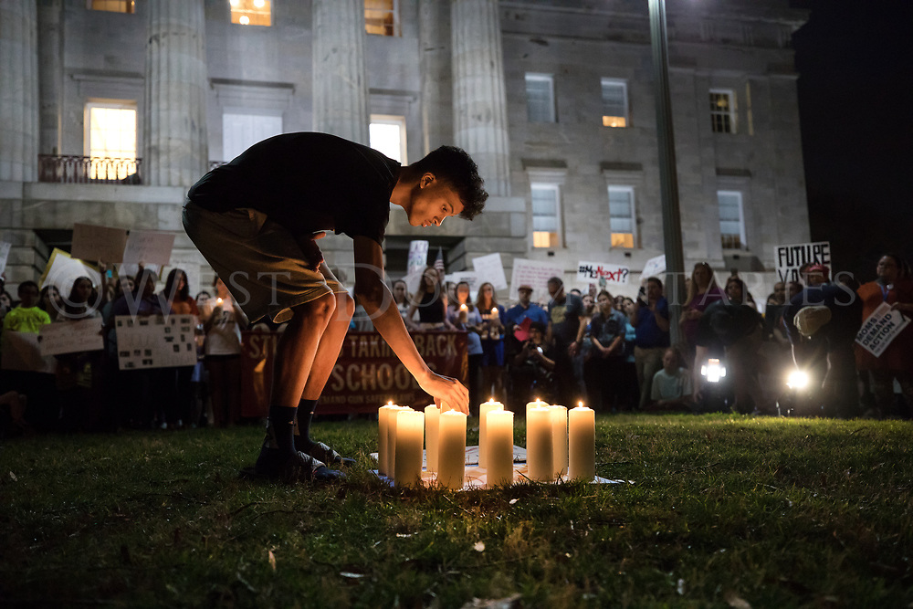 A crowd of hundreds gathered in front of the North Carolina State Capitol in Raleigh on Feb. 20, 2018, and placed 17 candles in remembrance to the students who lost their lives in a school shooting at Marjory Stoneman Douglas High School, Parkland, Fla., on Wednesday, Feb. 14, 2018. The crowd assembled at Pullen Memorial Baptist Church in Raleigh and marched about 1.5 miles down Hillsborough Street to the state capitol, where they gathered to pay their respects and call an end to gun violence, challenging politicians to enact more stringent laws.