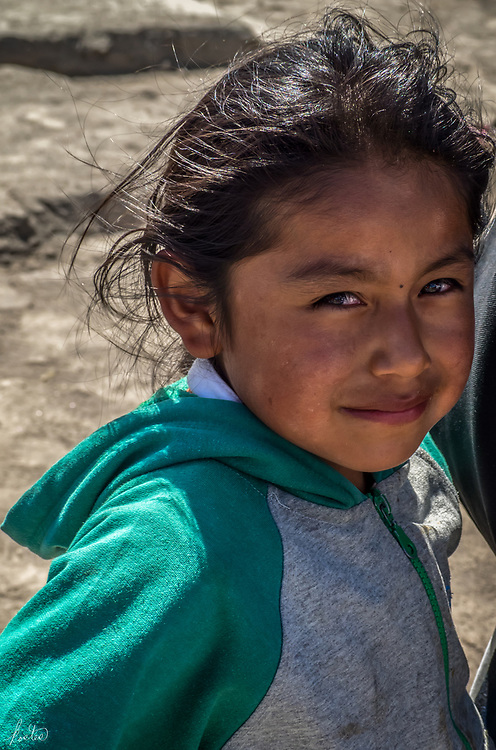 A candid portrait of a Kichwa child at the Kapak Raymi ceremony
