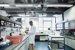 Male scientists working in a pharmacy laboratory, Freiburg im Breisgau, Baden-Wuerttemberg, Germany