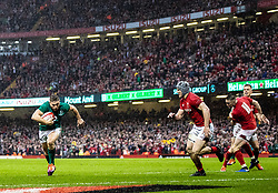 Jordan Larmour of Ireland scores his sides first try<br /> <br /> Photographer Simon King/Replay Images<br /> <br /> Six Nations Round 5 - Wales v Ireland - Saturday 16th March 2019 - Principality Stadium - Cardiff<br /> <br /> World Copyright © Replay Images . All rights reserved. info@replayimages.co.uk - http://replayimages.co.uk