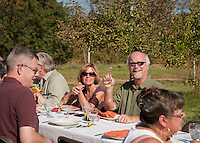 """Pamela and Terry Payton enjoy a toast with friends visiting from London during Sunday's """"Breakfast in the Orchard"""" with the Local Eatery at Smith's Orchard in Belmont.   (Karen Bobotas/for the Laconia Daily Sun)"""