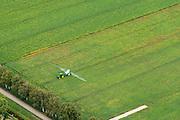 Nederland, Groningen, Stadskanaal, 27-08-2013;<br /> Landbouwer besproeit de aardappelplanten.<br /> Farmer sprays the potato plants.<br /> luchtfoto (toeslag op standaard tarieven);<br /> aerial photo (additional fee required);<br /> copyright foto/photo Siebe Swart.