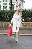 Leila Russack spotted in  London, wearing Maison Michel hat, Stuart Weizmann boots and a sky blue knit dress