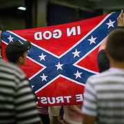 Trump supporters hold up a Confederate Flag at a Trump rally in Asheville, NC.