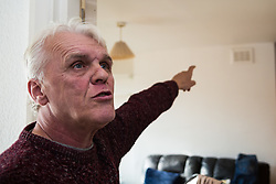 Retired James Gosling, 58, points to where water levels rose during a sewage flood. He is involved in a long running dispute with Camden council that began when his flat was flooded with sewage. West Hampstead, London, October 25 2018.