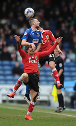 Oldham Athletic's Carl Winchester challenges for the header with Bristol City's Luke Freeman and Bristol City's Joe Bryan - Photo mandatory by-line: Dougie Allward/JMP - Mobile: 07966 386802 - 03/04/2015 - SPORT - Football - Oldham - Boundary Park - Bristol City v Oldham Athletic - Sky Bet League One